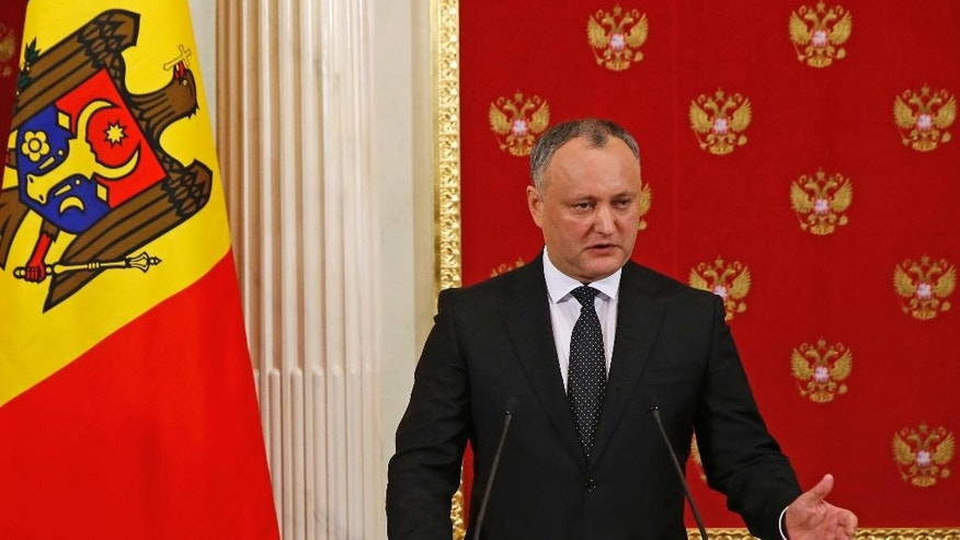 "Moldovan President Igor Dodon speaks at a joint news conference with Russian President Vladimir Putin in the Kremlin in Moscow, Russia, Tuesday, Jan. 17, 2017. Moldova's new president, who is visiting Russia on his first trip abroad, is voicing hope for rebuilding ""strategic"" ties with Moscow. (Sergei Ilnitsky/Pool Photo via AP)"