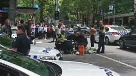Police and emergency services gather at the scene after a car is believed to have hit pedestrians in Bourke Street Mall in Melbourne, Australia, Friday, Jan. 20, 2017. Several pedestrians were injured after being struck by a car in Australia's second-largest city on Friday, prompting a major police operation as officials told the public to stay away from the area. (Luke Costin/AAP via AP)