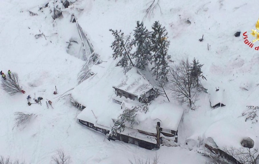 An aerial view shows Hotel Rigopiano in Farindola, central Italy, hit by an avalanche, in this January 19, 2017 handout picture provided by Italy's firefighters. Vigili del Fuoco/Handout via REUTERS ATTENTION EDITORS - THIS IMAGE WAS PROVIDED BY A THIRD PARTY. EDITORIAL USE ONLY.          TPX IMAGES OF THE DAY - RTSW7FQ