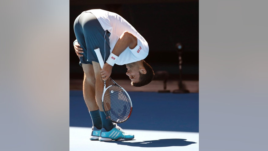 Serbia's Novak Djokovic bends over while playing Uzbekistan's Denis Istomin during their second round match at the Australian Open tennis championships in Melbourne, Australia, Thursday, Jan. 19, 2017. (AP Photo/Kin Cheung)