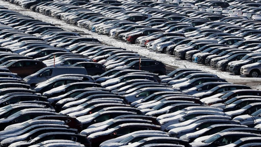 New vehicles of carmaker Hyundai are lined up at a logistic park in Kehlheim, near Regensburg, Thursday, Jan. 19, 2017. (AP Photo/Matthias Schrader)