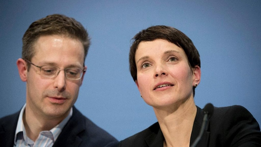 FILE - In this Dec. 16, 2016 file photo head of the nationalist party Alternative for Germany, AfD,  Frauke Petry her husband Marcus Pretzell are pictured in Berlin, Germany. On Saturday, Jan. 21, 2017 - a day after the inauguration of the 45th president of the United States -  nationalist leaders from Germany, France, the Netherlands and Italy plan to spell out a vision for Europe at a meeting in Koblenz, Germany, that will echo many of Donald Trump's talking points on immigration, Islam and relations with Russia. (Kay Nietfeld/dpa via AP)
