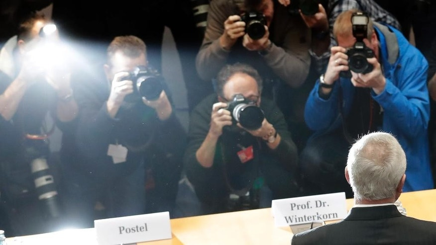 Martin Winterkorn, right, former CEO of the German car manufacturer Volkswagen, is surrounded by media after arriving for a questioning at an investigation committee of the German federal parliament in Berlin, Germany, Thursday, Jan. 19, 2017. (AP Photo/Ferdinand Ostrop)