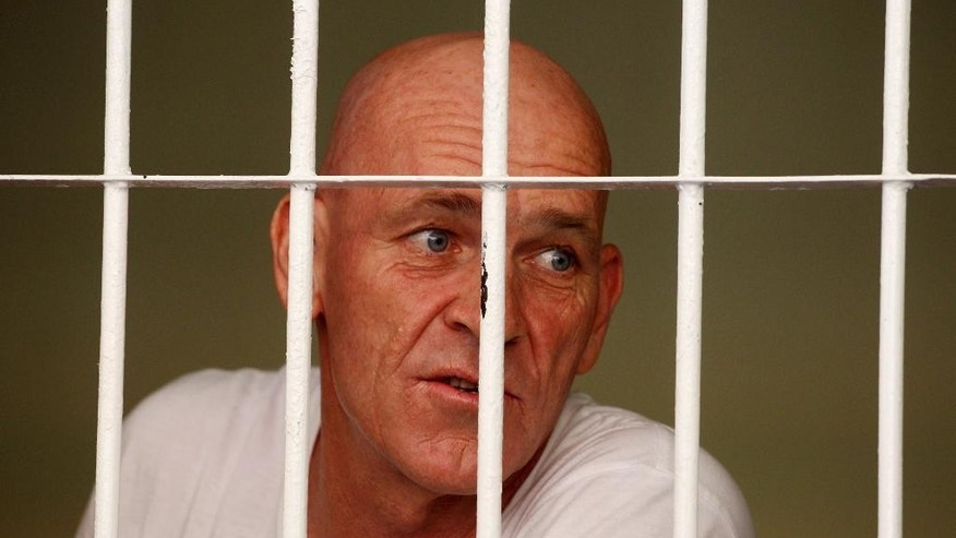 British national and former news correspondent David Fox inside his cell speaks to his lawyer after his trial in Bali, Indonesia, Thursday, Jan. 19, 2017. Indonesian police arrested David Fox October last year for allegedly possessing hashish. (AP Photo/Firdia Lisnawati)