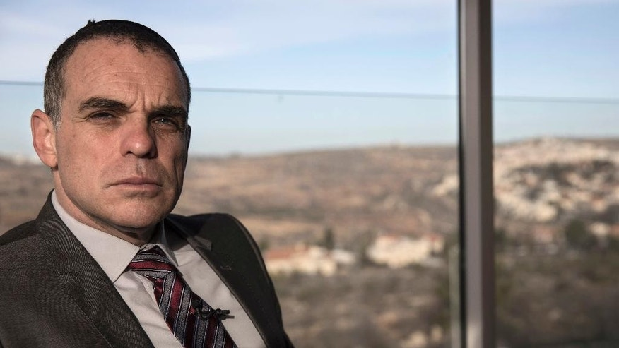 In this Wednesday, Jan. 18, 2017 photo, Israeli Mayor Oded Revivi, who will lead a delegation of officials from the Yesha settlers' council poses for a portrait in the Jewish settlement of Efrat. For nearly 50 years, Israel's West Bank settler movement has been criticized, condemned and ostracized by the international community. But on Friday, they say they will be greeted with open arms on the world's biggest stage as invited guests to Donald Trump's inauguration. (AP Photo/Tsafrir Abayov)