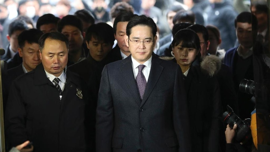 In this Wednesday, Jan. 18, 2017, photo, Lee Jae-yong, center, a vice chairman of Samsung Electronics Co. arrives for the hearing at the Seoul Central District Court in Seoul, South Korea. Many South Koreans were shocked at the sight of Lee being dragged into custody and then released when a court declined to formally arrest him. Its quite difficult for outsiders to fully grasp how Samsung is inextricably woven into the psychological fabric of this small, proud country. (AP Photo/Lee Jin-man)
