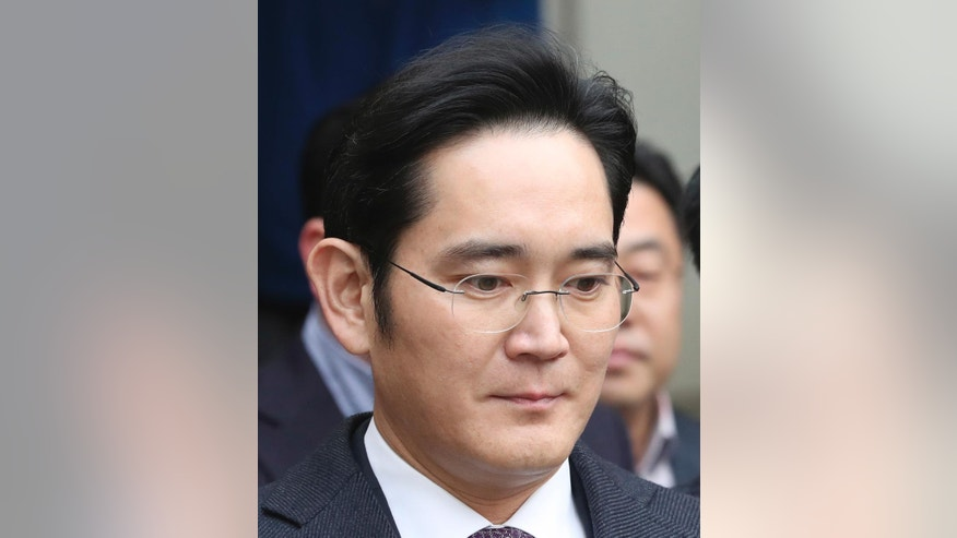In this Wednesday, Jan. 18, 2017 photo, Lee Jae-yong, a vice chairman of Samsung Electronics Co. leaves after attending the hearing at the Seoul Central District Court in Seoul, South Korea. Many South Koreans were shocked at the sight of Lee being dragged into custody and then released when a court declined to formally arrest him. Its quite difficult for outsiders to fully grasp how Samsung is inextricably woven into the psychological fabric of this small, proud country. (AP Photo/Lee Jin-man)