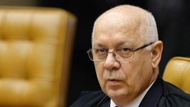FILE-  In this March 4, 2015, file photo, Brazil's Supreme Court Justice Teori Zavascki attends a session of the Supreme Court in Brasilia, Brazil. Zavascki's son said that his father was on a plane that crashed off the coast of the city in Rio de Janeiro, Thursday, Jan. 19, 2017. (AP Photo/Eraldo Peres, File)