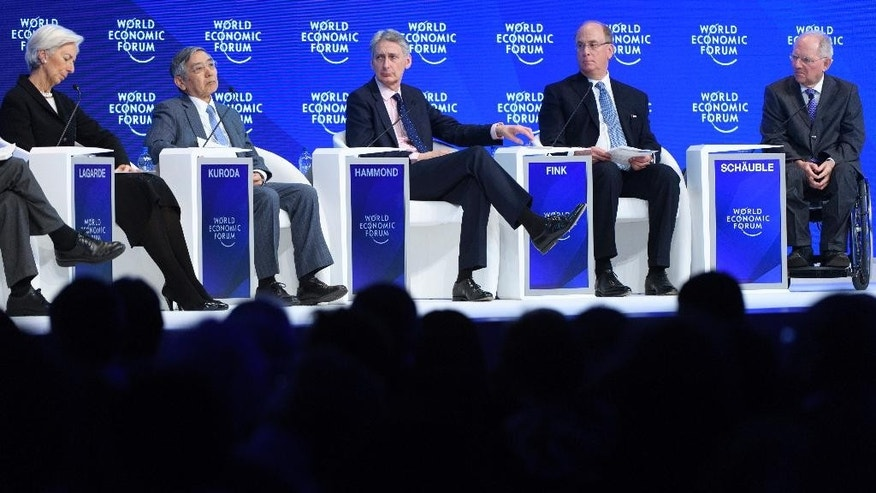 From left, France's Christine Lagarde, Managing Director of the International Monetary Fund, IMF, Bank of Japan Governor Haruhiko Kuroda, British Treasury Chief Philip Hammond, Laurence D. Fink, Chairman and CEO of BlackRock Inc. and German Finance Minister Wolfgang Schaeuble attend a plenary session during the closing day of the 47th annual meeting of the World Economic Forum, WEF, in Davos, Switzerland, Friday, Jan. 20, 2017. (Laurent Gillieron/Keystone via AP)