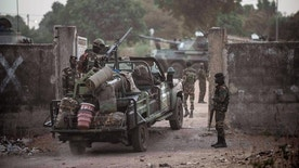 Senegal soldiers providing security at their gathering point on the Gambia boarder with Senegal at the town of Karang, Senegal, Friday, Jan. 20, 2017. The chief of Gambia's defense forces pledged his allegiance Friday to the new president, while the leaders of Guinea and Mauritania tried to persuade the defeated one to cede power in the West African nation. (AP Photo/Sylvain Cherkaoui)