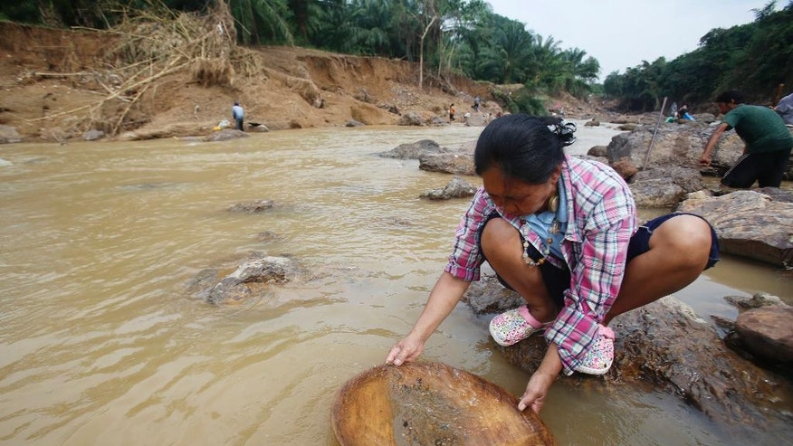 "In this Jan. 19, 2017, photo, locals pan for gold in the Klong Thong, or ""Golden Canal"" in Prachuap Khiri Khan province, southern Thailand. The canal, expanded by devastating flash floods, has been washing up gold for villagers whose businesses have been swept away. (AP Photo/Sakchai Lalit)"