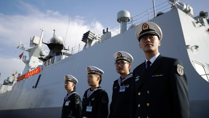 FILE - In this Wednesday, Dec. 7, 2016, file photo, Chinese Navy officials stand in front of the ship Daqing, in San Diego. China has appointed the former head of its southern fleet as the new commander of its increasingly powerful navy. Vice Adm. Shen Jinlong takes command of a sprawling force that is growing in both size and modernity as China seeks to assert its regional maritime claims and project strength far from its shores. (AP Photo/Gregory Bull, File)