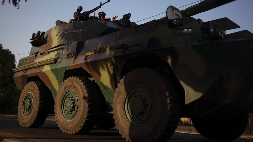 A convoy of Senegal soldiers en route towards the Gambia boarder with Senegal near Karang, Senegal, Thursday, Jan. 19, 2017. Senegalese troops charged into neighboring Gambia late Thursday to support the country's newly inaugurated president, while longtime ruler Yahya Jammeh showed no sign of stepping down. (AP Photo/Sylvain Cherkaoui)
