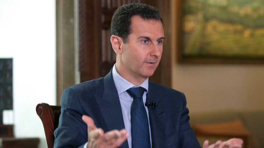 FILE -- In this Wednesday, Sept. 21, 2016 photo released by the Syrian Presidency, Syrian President Bashar Assad speaks to The Associated Press at the presidential palace in Damascus, Syria.