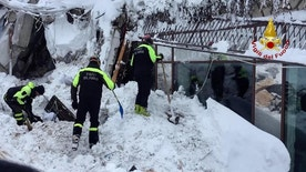 Italian firefighters search for survivors after an avalanche buried a hotel near Farindola, central Italy, Thursday, Jan. 19, 2017. Rescue crews are continuing the painstaking search for some 30 people trapped inside a remote Italian mountain resort flattened by a huge avalanche. (Italian Firefighters/ANSA via Italian Firefighters)