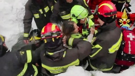 This frame from video shows Italian firefighters extracting a woman alive from under snow and debris of an hotel that was hit by an avalanche on Wednesday, in Rigopiano, central Italy, Friday, Jan. 20, 2017. (Italian Firefighters/ANSA via AP)
