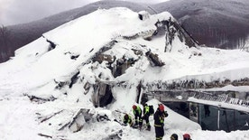 Italian firefighters search for survivors after an avalanche buried a hotel near Farindola, central Italy, Thursday, Jan. 19, 2017. Rescue workers on skis reached a four-star spa hotel buried by an avalanche in earthquake-stricken central Italy Thursday, reporting no signs of life as they searched for around 30 people believed trapped inside.  (Italian Firefighters/ANSA via Italian Firefighters)