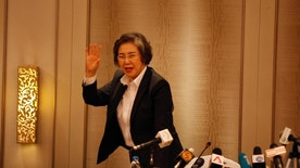 Yanghee Lee, UN Human Rights Special Rapporteur to Myanmar, waves as she leaves a press briefing at a hotel Friday, Jan. 20, 2017, in Yangon, Myanmar. Lee visited conflict areas including Kachin and Rakhine State and met with government officials during her trip to Myanmar. (AP Photo/Thein Zaw)