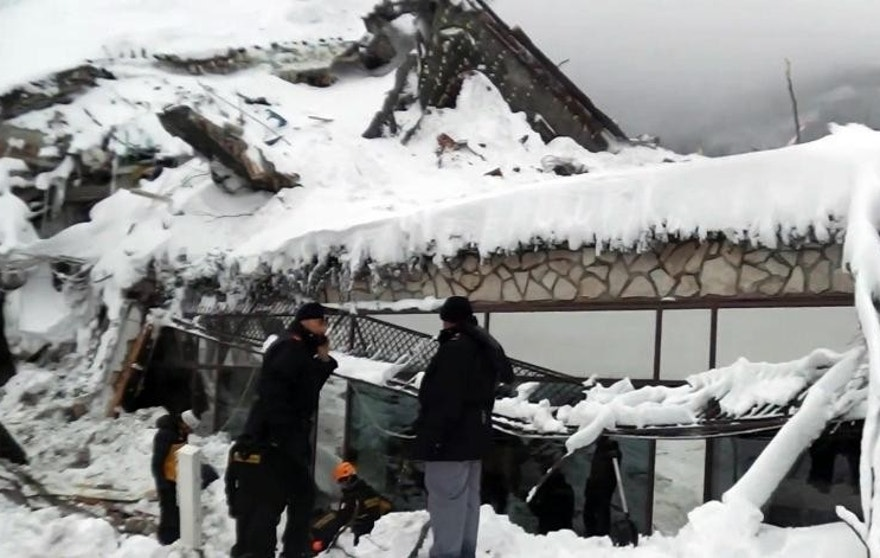 "Rescuers work at the avalanche-hit Rigopiano hotel, Saturday, Jan. 21, 2017. After two days huddled in freezing cold, tons of snow surrounding them in the wreckage of the avalanche-demolished hotel, survivors greeted their rescuers Friday as ""angels."" Among the 10 people pulled out alive was a plucky 6-year-old who just wanted her favorite cookies. (Corpo Nazionale Soccorso Alpino e Speleologico/The National Alpine Cliff and Cave Rescue Corps (CNSAS) via AP)"