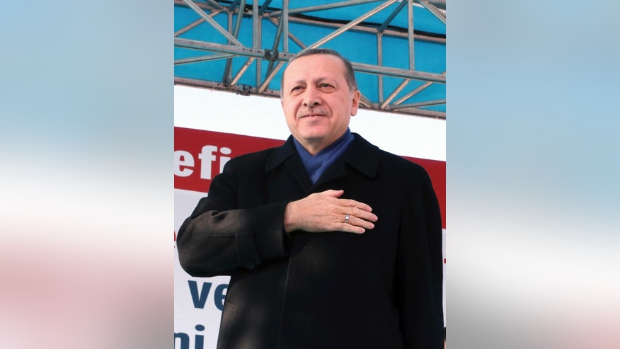 Turkey's President Recep Tayyip Erdogan salutes his supporters in Istanbul, Saturday, Jan. 21, 2017. Erdogan started campaigning for constitutional reforms that would greatly expand the powers of his office on Saturday, hours after a vote in parliament cleared the way for a national referendum on the issue. (Kayhan Ozer/Presidential Press Service, Pool Photo via AP