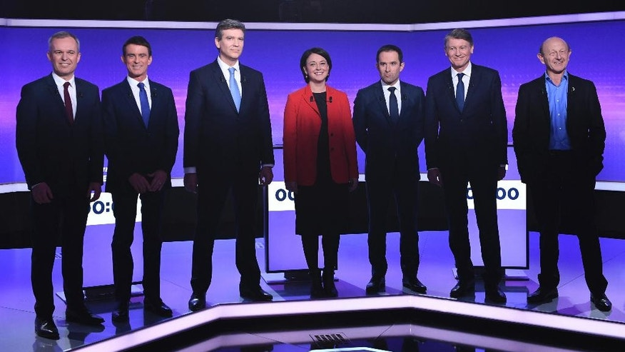 Candidates for the French left's presidential primaries ahead of the 2017 presidential election, (from L) Francois de Rugy, Manuel Valls, Arnaud Montebourg, Sylvia Pinel, Benoit Hamon, Vincent Peillon, Jean-Luc Bennahmias pose before taking part in a final televised debate in Paris, France, Thursday, Jan. 19, 2017. Seven competitors are bidding to be the Socialist Party's candidate in next spring's French presidential election. (Eric Feferberg/Pool Photo via AP)