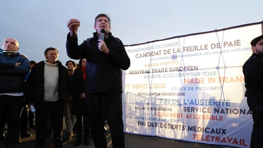 "Former Economy minister and now candidate in the French left's presidential primaries Arnaud Montebourg, center, talks during a meeting in the Old-Port of Marseille, southern France, Friday, Jan. 20, 2017. Seven competitors are bidding to be the Socialist Party's candidate in next spring's French presidential election. Banner reads ""Candidate of the pay slip-New European treaty-6th republic"". (AP Photo/Claude Paris)"