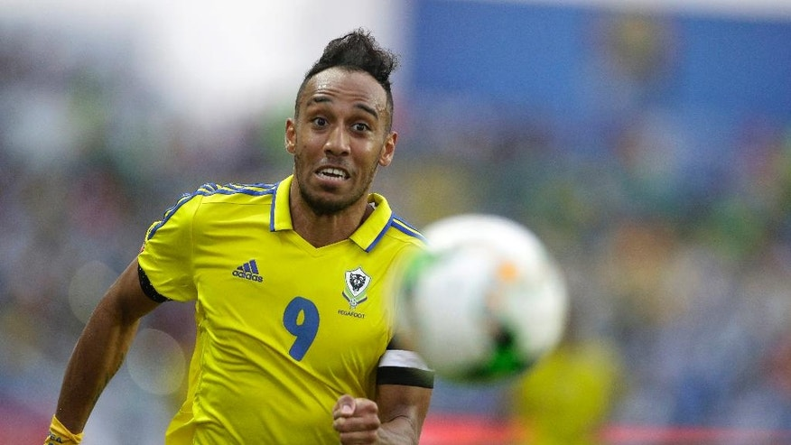 Gabon's Pierre Emerick Aubameyang follows the ball during the African Cup of Nations Group A soccer match between Gabon and Burkina Faso at the Stade de l'Amitie, in Libreville, Gabon Wednesday Jan. 18, 2017. (AP Photo/Sunday Alamba)