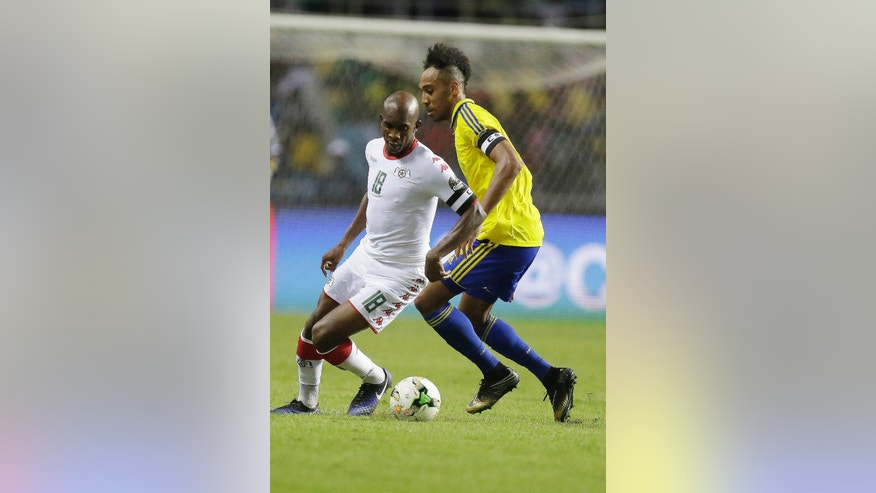 Gabon's Pierre Emerick Aubameyang, right, is challenged by Burkina Faso's Charles Kabore during the African Cup of Nations Group A soccer match between Gabon and Burkina Faso at the Stade de l'Amitie, in Libreville, Gabon, Wednesday Jan. 18, 2017. (AP Photo/Sunday Alamba)