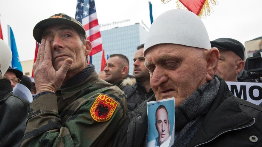 Protesters hold a portrait of Ramush Haradinaj, Kosovo's former prime minister and a former guerrilla fighter, during a protest demanding immediate release from French judicial supervision in Kosovo's capital Pristina on Saturday, Jan 21, 2017. A French court ordered the release of Haradinaj pending a decision on whether to extradite him to Serbia, where he's wanted on war crimes charges. Haradinaj, a former guerrilla fighter in Kosovo's 1998-1999 war for independence from Serbia, was cleared of war crimes charges by a U.N. tribunal. (AP Photo/Visar Kryeziu)