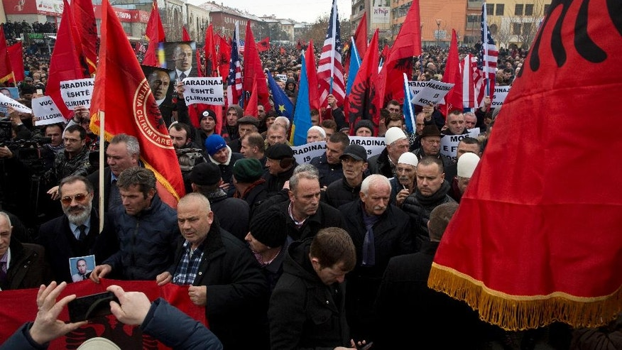 Thousands of protesters waving Albanian, Kosovan and U.S flags march during a protest demanding the immediate release from French judicial supervision of Ramush Haradinaj, Kosovo's former prime minister and a former guerrilla fighter, in Kosovo's capital Pristina on Saturday, Jan 21, 2017. A French court ordered the release of Haradinaj pending a decision on whether to extradite him to Serbia, where he's wanted on war crimes charges. Haradinaj, a former guerrilla fighter in Kosovo's 1998-1999 war for independence from Serbia, was cleared of war crimes charges by a U.N. tribunal. (AP Photo/Visar Kryeziu)