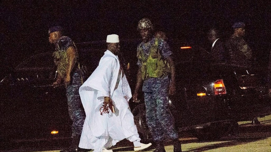 Gambia's defeated leader Yahya Jammeh departs at Banjul airport Saturday Jan. 21, 2017. Jammeh announced early Saturday he has decided to relinquish power, after hours of last-ditch talks with regional leaders and the threat by a regional military force to make him leave. (AP Photo/Jerome Delay)