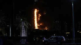 File - In this Jan. 31, 2015, photo, smoke and flames pour out of the 63-story The Address Downtown, in Dubai, United Arab Emirates. Dubai authorities announced Sunday, Jan. 22, 2017, that the city-state had new fire safety regulations, but offered few details on how they would be enforced after a series of skyscraper fires. (AP Photo/Sunday Alamba)