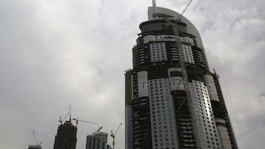 The Address Downtown, a 63-story building that caught fire on Dec. 31, 2015, is seen as it undergoes repairs in Dubai, United Arab Emirates, on Sunday, Jan. 22, 2017. Dubai authorities announced Sunday the city-state had new fire safety regulations, but offered few details on how they would be enforced after a series of skyscraper fires. (AP Photo/Jon Gambrell)