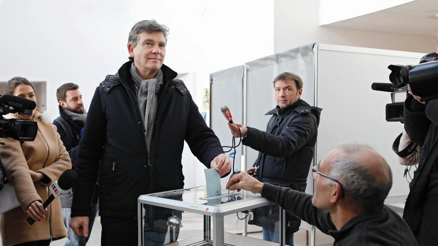 Former Economy minister Arnaud Montebourg looks on before voting during the first round of the French left's presidential primary election, in Montret, eastern France, Sunday, Jan. 22, 2017. Seven candidates are running in the first round of France's left-wing presidential primary, whose winner will face a tough challenge from the right and nationalist far right in the April-May general election. (AP Photo/Laurent Cipriani)