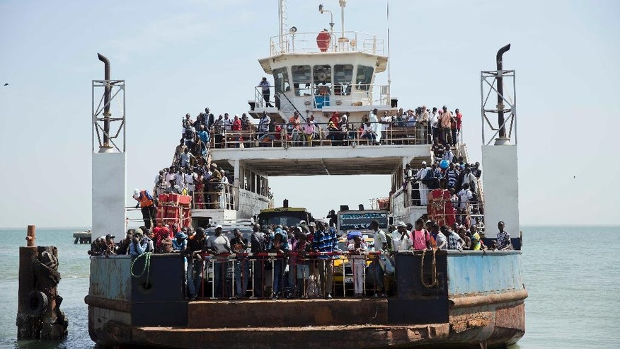 A ferry bringing back people who fled arrives at the port in Banjul, Gambia as it reopens Saturday Jan. 21, 2017. life slowly returns to the Gambian capital as Gambia's defeated leader Yahya Jammeh announced early Saturday he has decided to relinquish power, after hours of last-ditch talks with regional leaders and the threat by a regional military force to make him leave.AP Photo/Jerome Delay)
