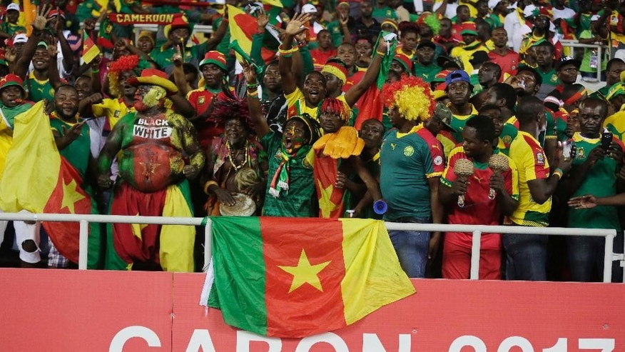 Cameroon's supporter chant ahead of the African Cup of Nations Group A soccer match between Cameroon and Gabon at the Stade de l'Amitie, in Libreville, Gabon, Sunday Jan. 22, 2017. (AP Photo/Sunday Alamba)