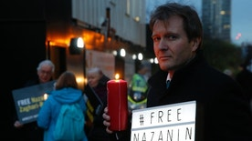 FILE -- In this Monday, Jan. 16, 2017 file photo, Richard Ratcliffe husband of imprisoned charity worker Nazanin Zaghari-Ratcliffe, poses for the media during an Amnesty International led vigil outside the Iranian Embassy in London. Iran has sentenced Zaghari-Ratcliffe, a British-Iranian woman accused of trying to overthrow the cleric-run government, to five years in prison, a news website affiliated with the judiciary reported Sunday. Zaghari-Ratcliffe, who works for the Thomson Reuters Foundation, the news agency's charitable arm, was detained in April 2016 while trying to leave the country with her toddler daughter, who remains in Iran with family after authorities seized her passport. (AP Photo/Alastair Grant, File)