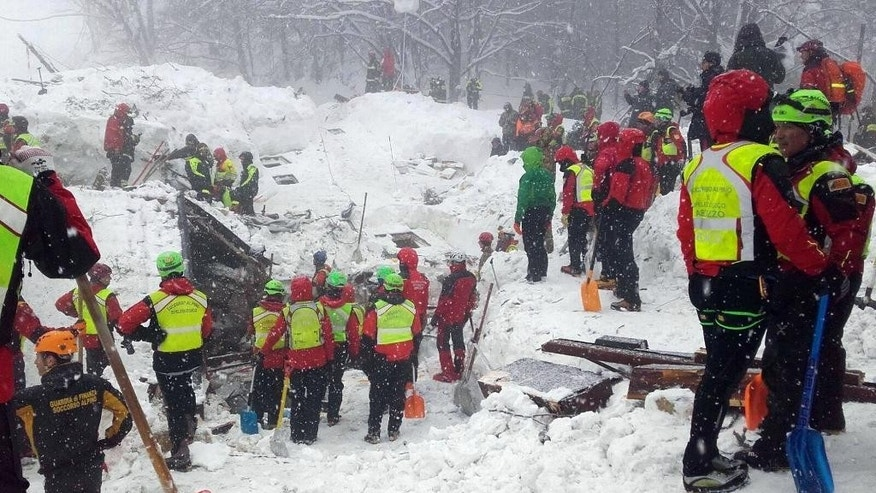 "In this undated photo released Sunday, Jan. 22, 2017, rescuers work in the area of the avalanche-hit Rigopiano hotel, central Italy.  After two days huddled in freezing cold, tons of snow surrounding them in the wreckage of the avalanche-demolished hotel, survivors greeted their rescuers Friday as ""angels."" Among the 10 people pulled out alive was a plucky 6-year-old who just wanted her favorite cookies. (Corpo Nazionale Soccorso Alpino e Speleologico/The National Alpine Cliff and Cave Rescue Corps (CNSAS) via AP)"