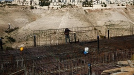 A worker stands in a construction site in the West bank settlement of Maaleh Adumim, Sunday, Jan. 22, 2017. The municipality of Jerusalem has granted final approval for the construction of hundreds of new homes in east Jerusalem, while a hard-line Cabinet minister pushed the government to annex Maaleh Adumim, a major West Bank settlement as emboldened Israeli nationalists welcomed the presidency of Donald Trump. The building plans were put on hold in the final months of President Barack Obama's administration. (AP Photo/Mahmoud Illean)