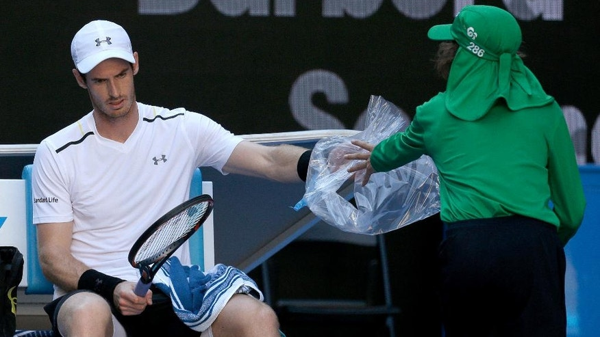 Britain's Andy Murray changes his racket while playing Germany's Mischa Zverev during their fourth round match at the Australian Open tennis championships in Melbourne, Australia, Sunday, Jan. 22, 2017. (AP Photo/Aaron Favila)
