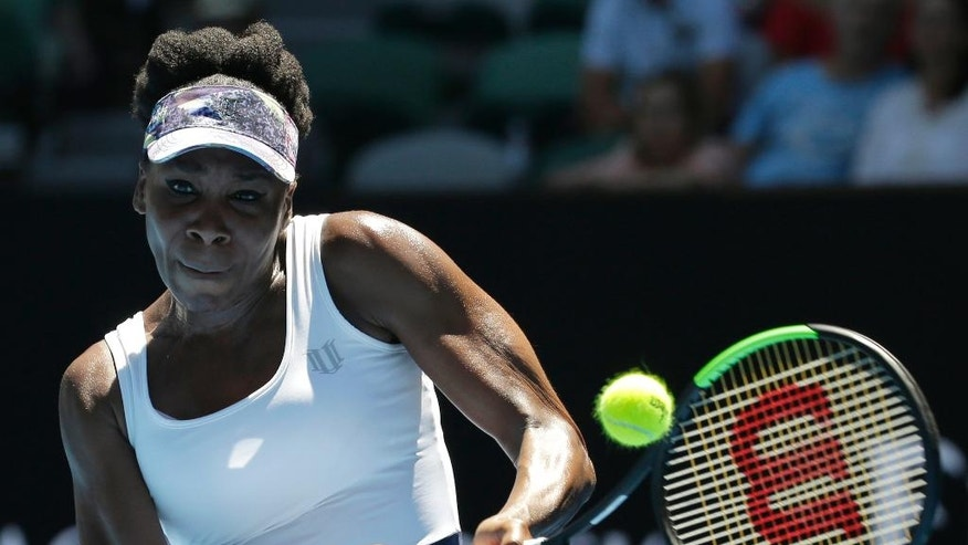 United States' Venus Williams makes a backhand return to Germany's Mona Barthel during their fourth round match at the Australian Open tennis championships in Melbourne, Australia, Sunday, Jan. 22, 2017. (AP Photo/Aaron Favila)