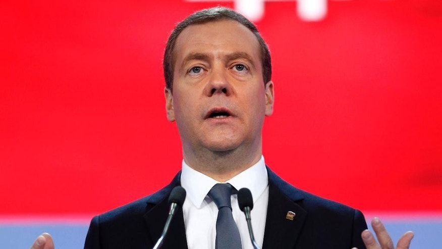 "Russian Prime Minister Dmitry Medvedev gestures as he speaks during a congress of United Russia Party in Moscow, Russia, Sunday, Jan. 22, 2017. Medvedev says sanctions on Russia are set to remain in place ""for a long time"" despite expectations the election of Donald Trump as U.S. president will lead to a thaw in relations between Washington and Moscow. (Dmitry Astakhov, Sputnik, Government Pool Photo via AP)"