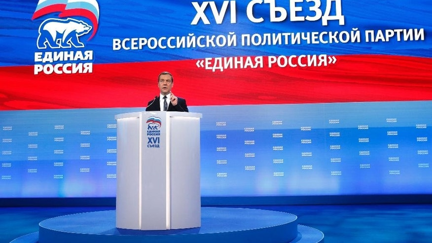 "Russian Prime Minister Dmitry Medvedev speaks during a congress of United Russia Party in Moscow, Russia, Sunday, Jan. 22, 2017. Medvedev says sanctions on Russia are set to remain in place ""for a long time"" despite expectations the election of Donald Trump as U.S. president will lead to a thaw in relations between Washington and Moscow. (Dmitry Astakhov, Sputnik, Government Pool Photo via AP)"