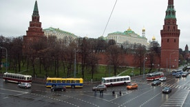 Vintage trolleybuses parade around the Kremlin in Moscow, Russia, Saturday, Nov. 16, 2013. Pieces of the Soviet past were crawling down some of Moscow's main streets as the city transportation system marked the 80th anniversary of the trolleybus system with a procession of vintage vehicles. The trolleybus system doesn't have the cachet of Moscow's art-festooned subway, but the cortege of buses dating back to the 1950s attracted a small throng when it stopped at the square outside the Bolshoi Theater on Saturday. (AP Photo/Pavel Golovkin)