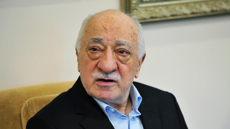 FILE - In this July 17, 2016 file photo, Islamic cleric Fethullah Gulen speaks to members of the media at his compound in Saylorsburg, Pa. While Turkish President Recep Tayyip Erdogan travels with a big business delegation to Tanzania, Mozambique and Madagascar this week, he is also focusing on what he calls a security threat. Turkey accuses international schools inspired by Muslim cleric Fethullah Gulen of providing militant recruits for his movement, which in turn says an increasingly authoritarian government is casting as wide a net as possible for perceived opponents. (AP Photo/Chris Post, File)