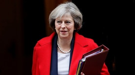 FILE - In this Wednesday, Nov. 23, 2016 file photo, Britain's Prime Minister Theresa May leaves 10 Downing Street to attend the weekly Prime Ministers' Questions session, in parliament in London. Prime Minister Theresa May's office says Thursday Jan. 5, 2017, the British leader will meet Donald Trump in Washington in the weeks following his Jan. 20 inauguration as U.S. president. (AP Photo/Kirsty Wigglesworth, File)