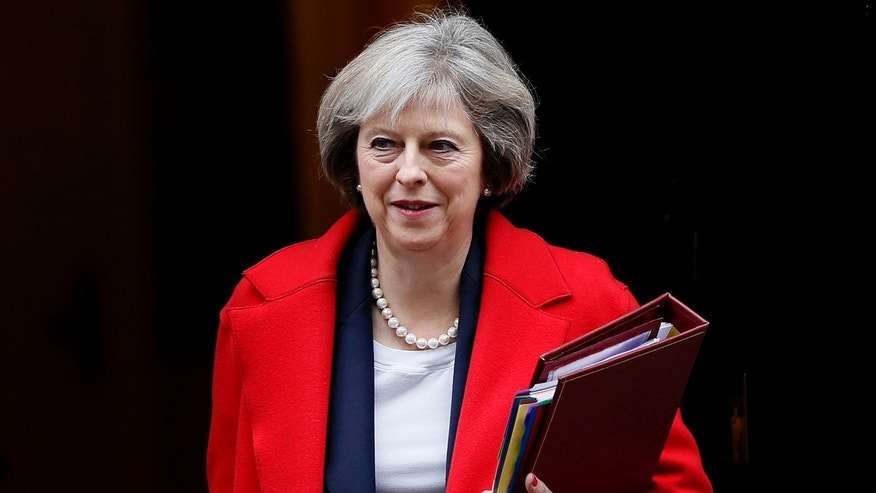 In this Wednesday, Nov. 23, 2016 file photo, Britain's Prime Minister Theresa May leaves 10 Downing Street to attend the weekly Prime Ministers' Questions session, in parliament in London.
