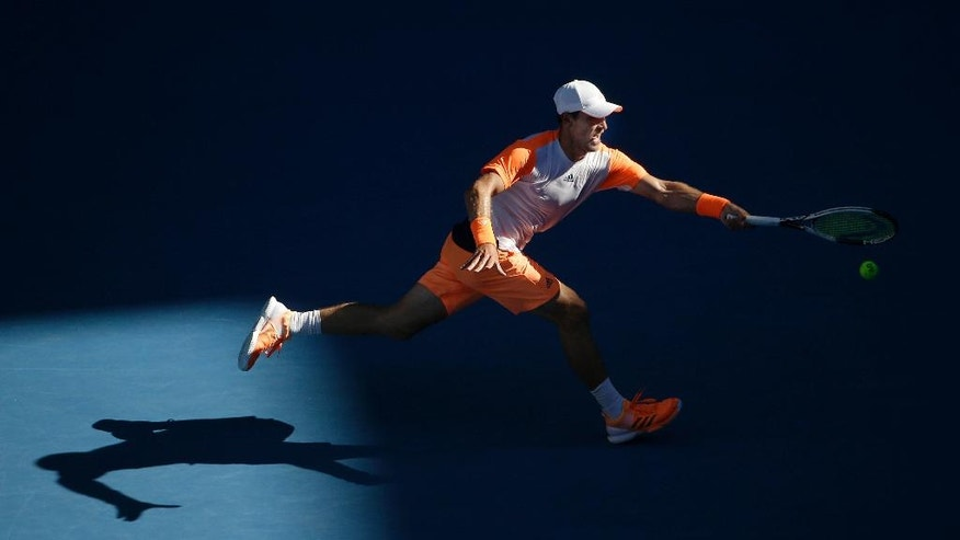 Germany's Mischa Zverev hits a forehand to Britain's Andy Murray during their fourth round match at the Australian Open tennis championships in Melbourne, Australia, Sunday, Jan. 22, 2017. (AP Photo/Dita Alangkara)