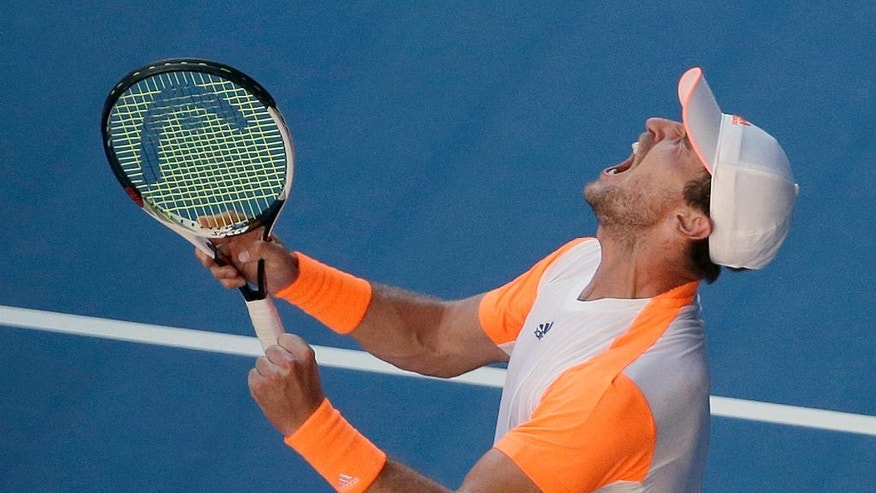 Germany's Mischa Zverev yells after defeating Britain's Andy Murray in their fourth round match at the Australian Open tennis championships in Melbourne, Australia, Sunday, Jan. 22, 2017. (AP Photo/Dita Alangkara)
