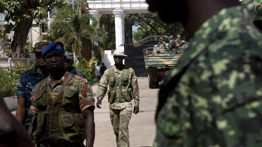 Senegalese troops enter the State House in Banjul, Gambia, Monday Jan. 23, 2017, two days after Gambia's defeated leader Yahya Jammeh left the country.  Troops of  Economic Community of West African States  have moved into the State House to prepare for the return of new President Adama Barrow.(AP Photo/Jerome Delay)
